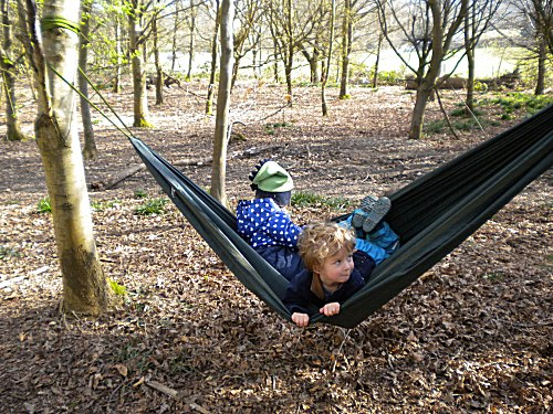Nicholas and Elsa try out the new forest kindergarten hammock